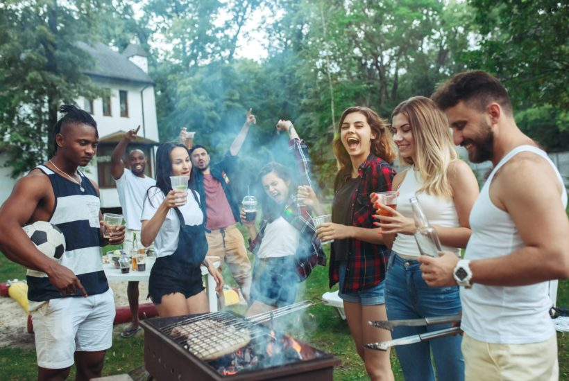 People stood around a barbeque
